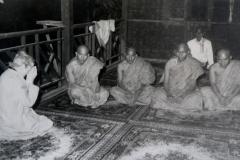 Marie showing respect for Burmese monks.